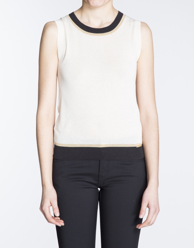 Beige knit top with black and beige trim