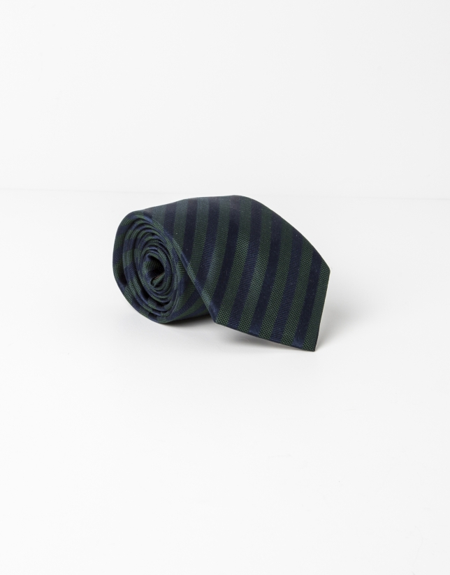 Green tie with navy and blue stripes