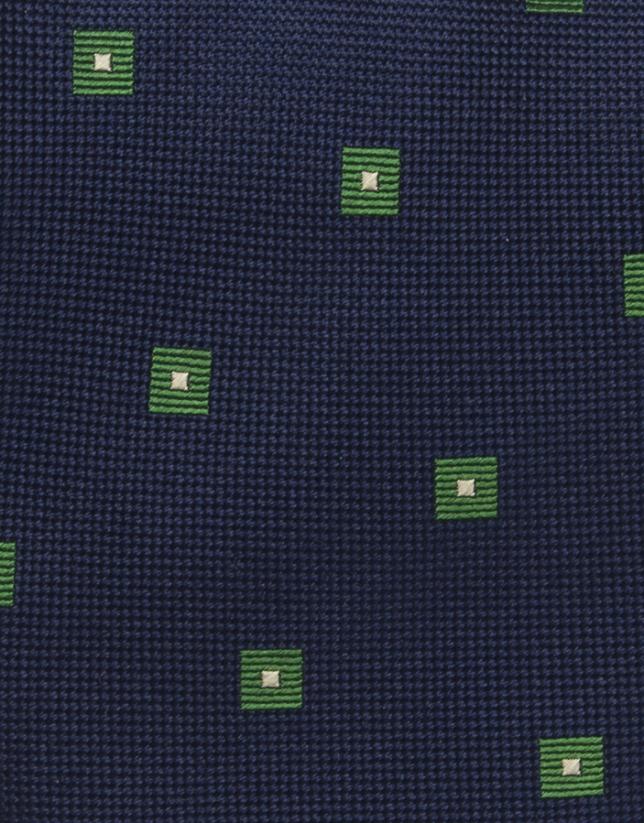 Cravate à petits carreaux verts sur fond bleu marine