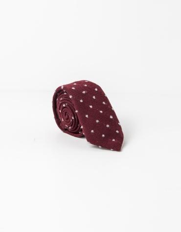 Corbata topos gris fondo granate