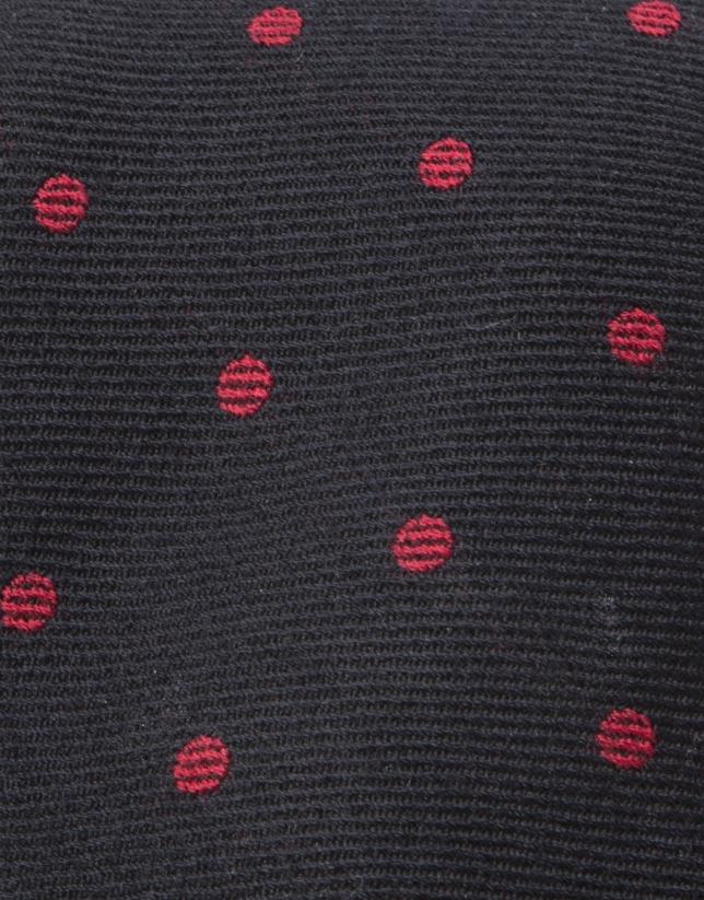 Corbata topos gris fondo negro