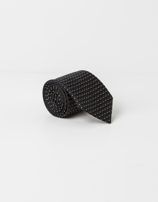 Corbata topos beige fondo negro
