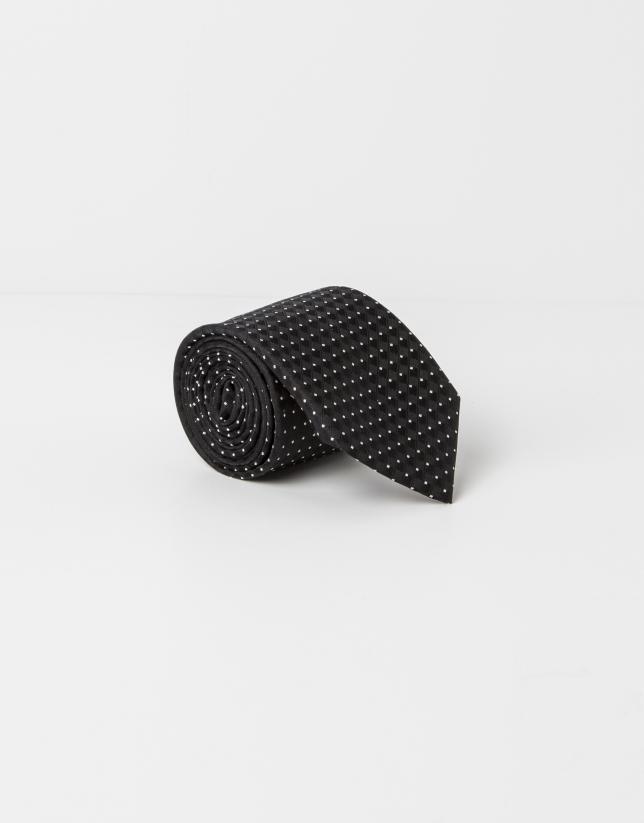 Cravate à pois beige sur fond noir