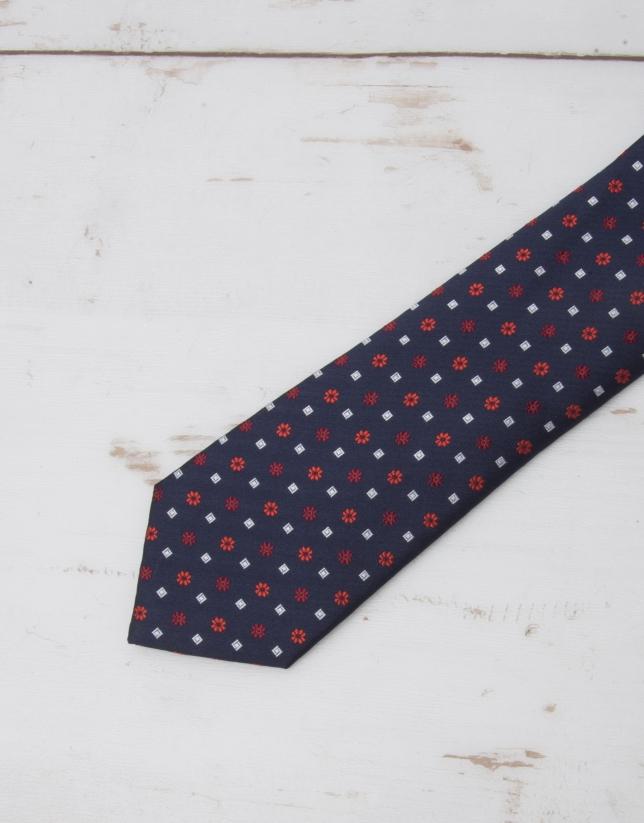 Cravate bleu marine fleurs en rouge
