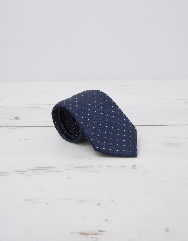 Cravate bleu marine à pois jaunes