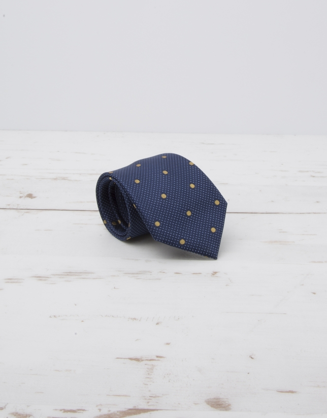 Cravate bleu marine à grands pois jaunes