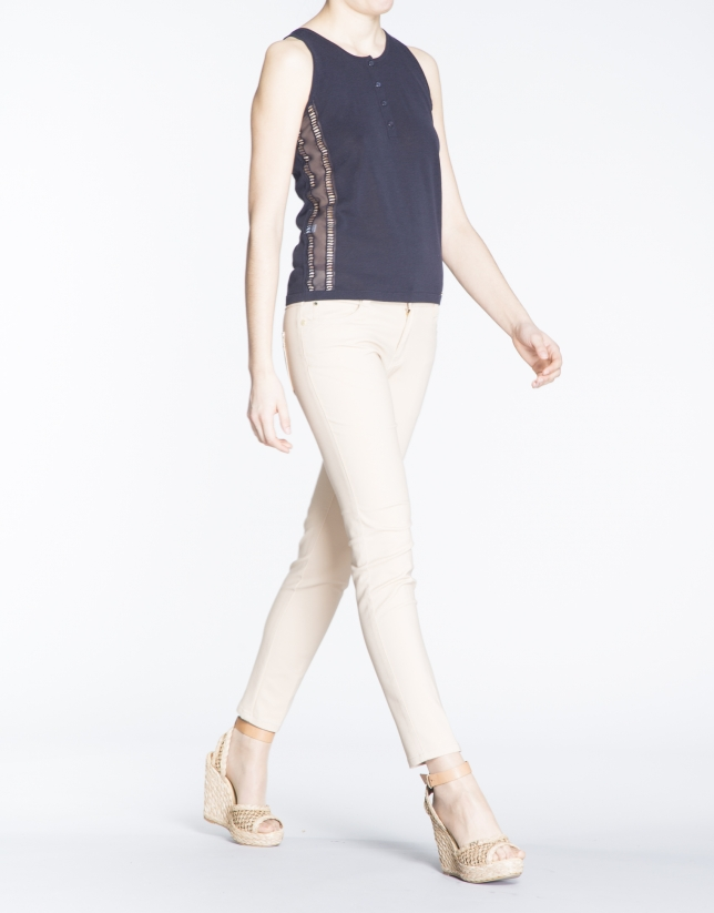 Navy blue knit top with passementerie on sides