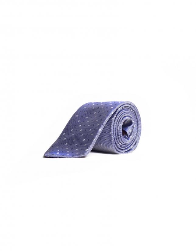 Tie with motifs