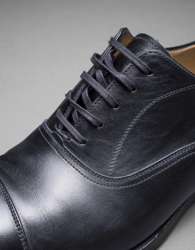 Black dress shoes with laces