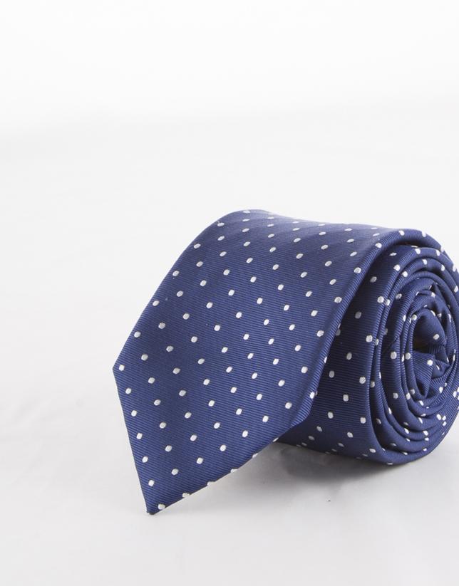 Cravate à pois blancs sur fond bleu