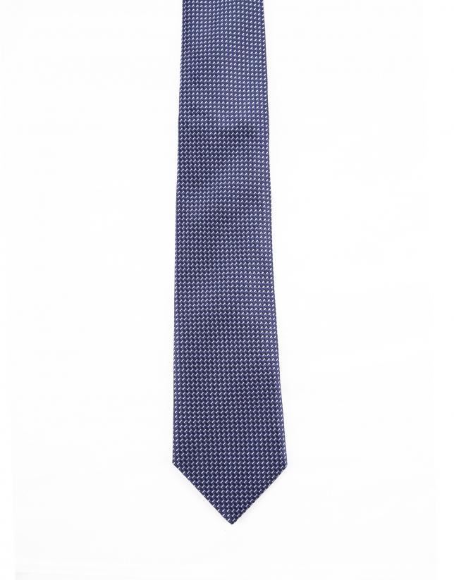 Cravate à motifs dans les tons tons bleus