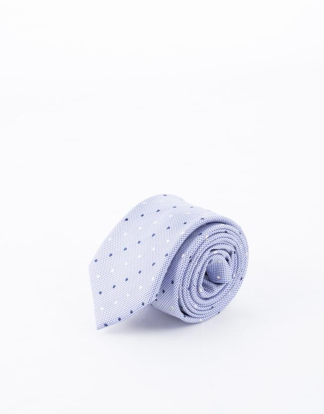 Cravate à motifs blancs et bleu marine