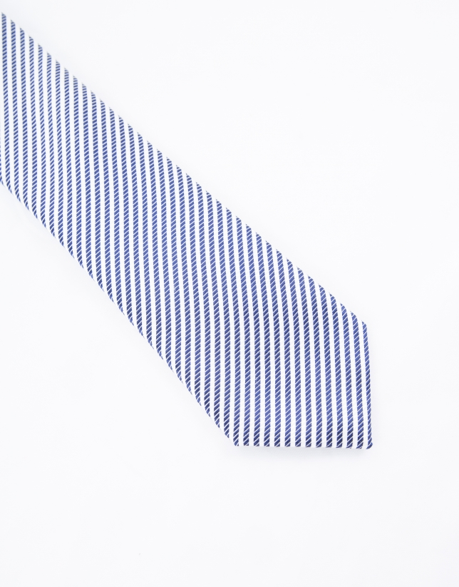 White and navy blue striped tie