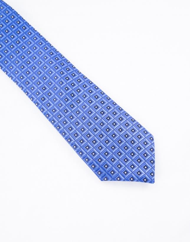 Cravate à motifs dans les tons bleus