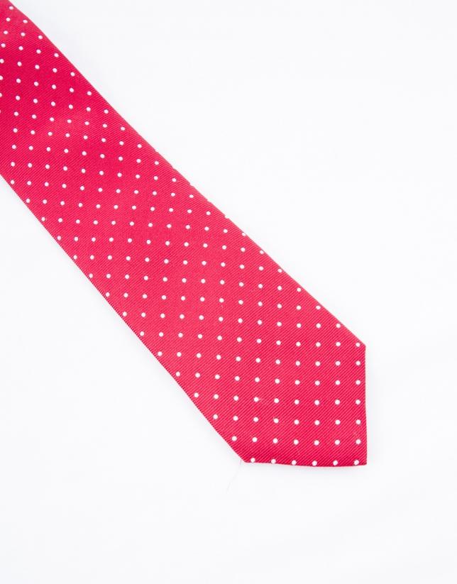 Cravate à pois blancs sur fond rouge