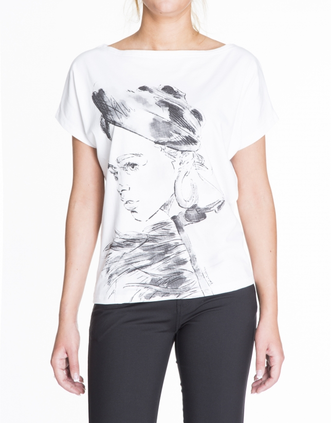 White top with short bat sleeves and drawing of girl