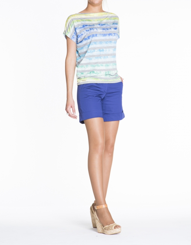 Loose gray striped top over blue, yellow and green print.