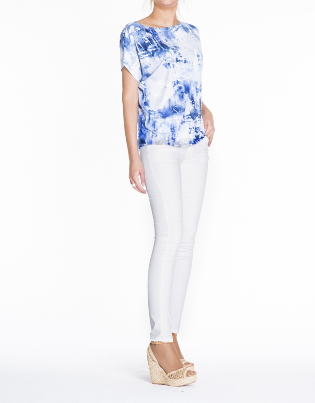 Loose white top with blue print