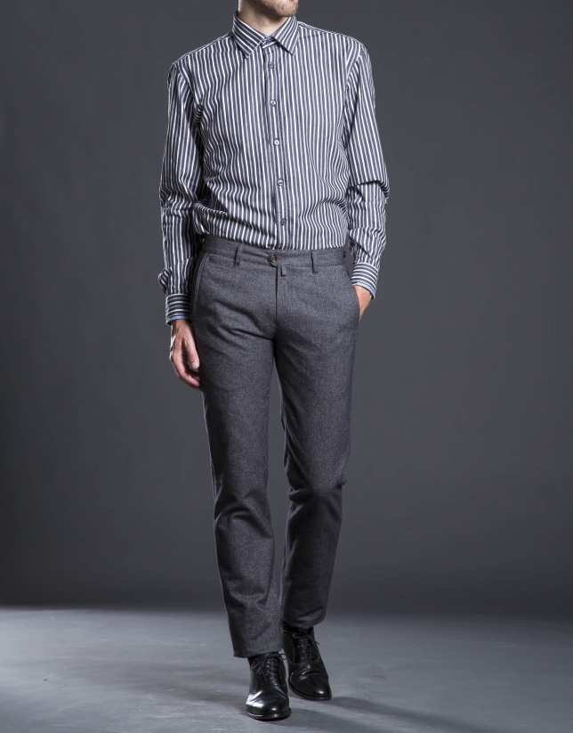 Gray striped sports shirt.