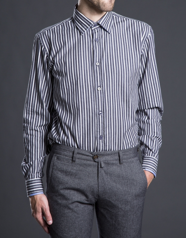 Gray striped sports shirt.