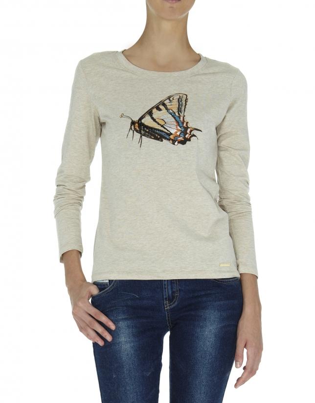Camiseta manga larga beige ilustración mariposa con strass y glitter.
