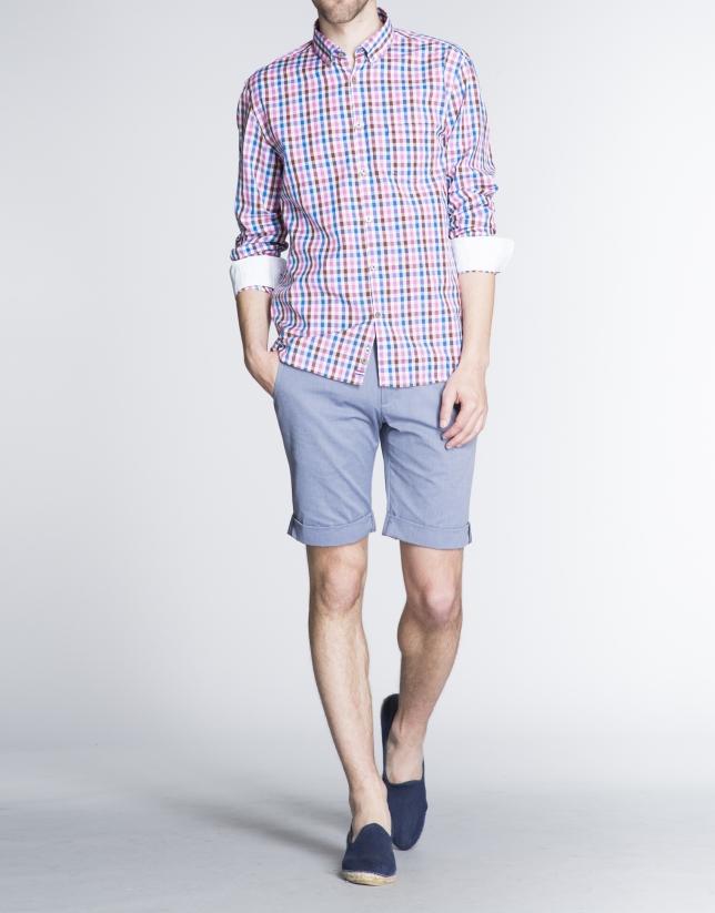 Blue herringbone cotton Bermuda shorts.