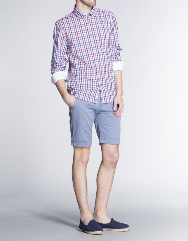 Blue herringbone cotton Bermuda shorts.