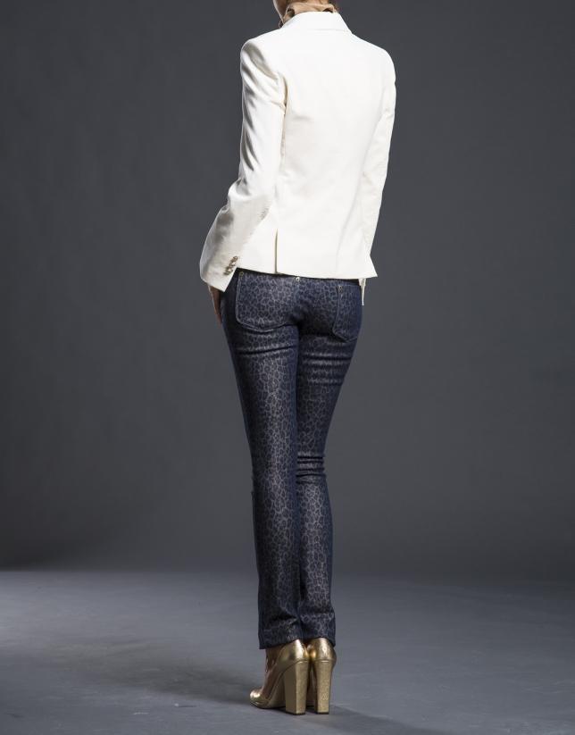 Blazer velours crème avec poches.