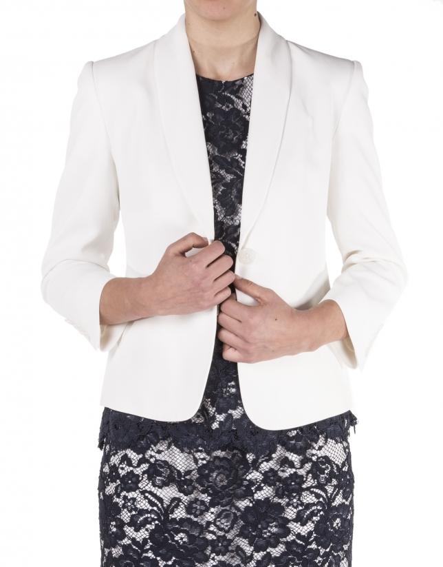 Beige blazer with tuxedo collar.
