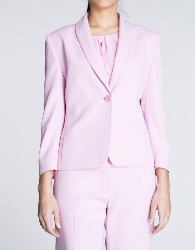 Pink blazer with tuxedo collar.