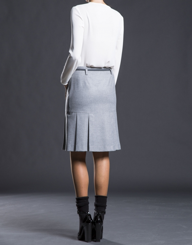 Gray skirt with bottom pleats.