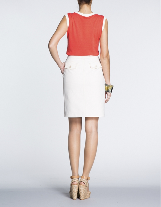 Falda recta de algodón crudo ivory con cremalleras.