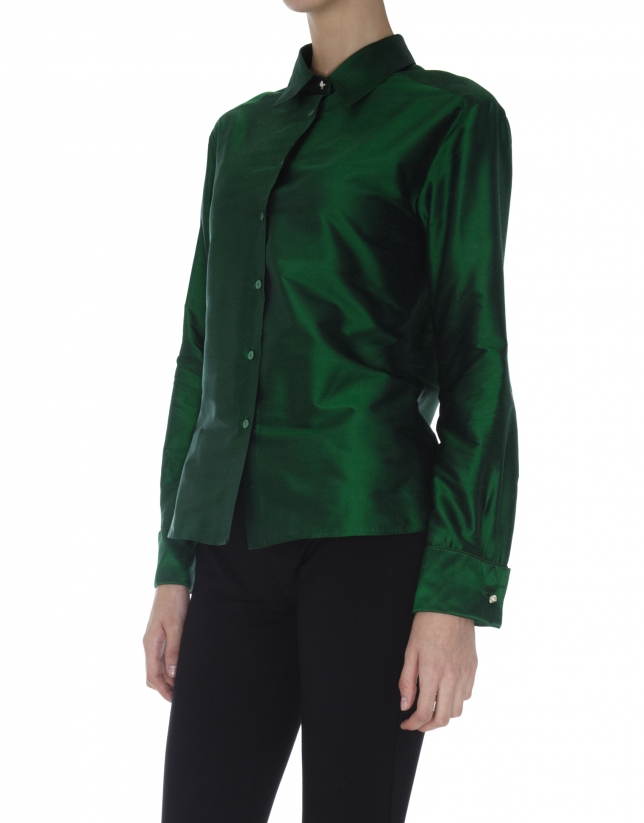 Green long- sleeved silk blouse