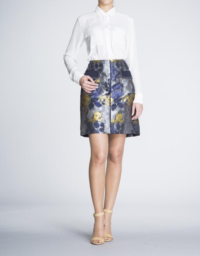 Falda recta estampada floral con bolsillos en delantero.