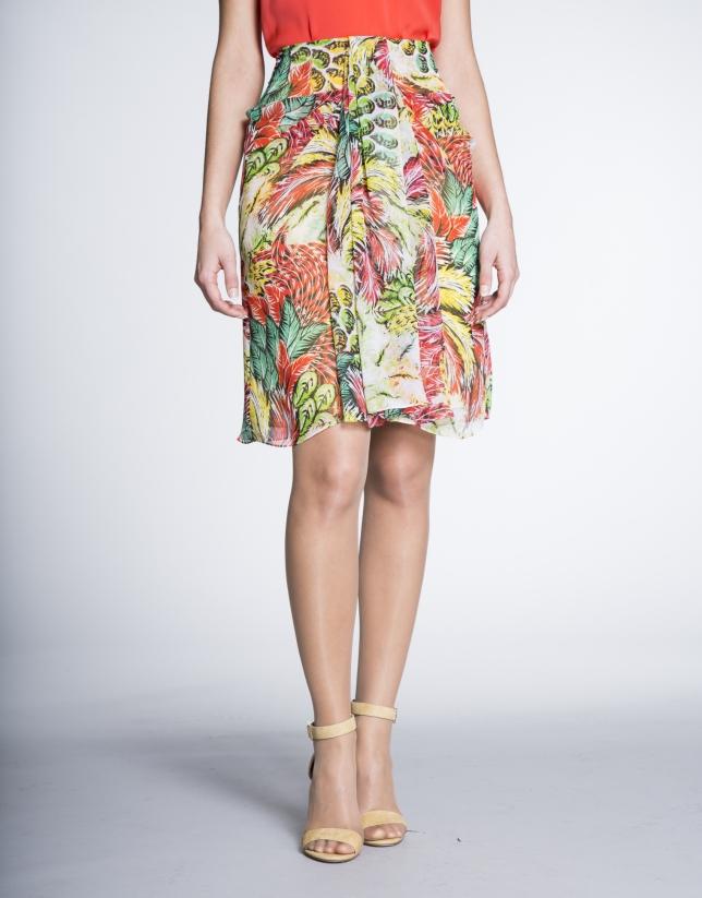 Falda con pliegue delantero estampada amarillo/coral en tejido vaporoso.