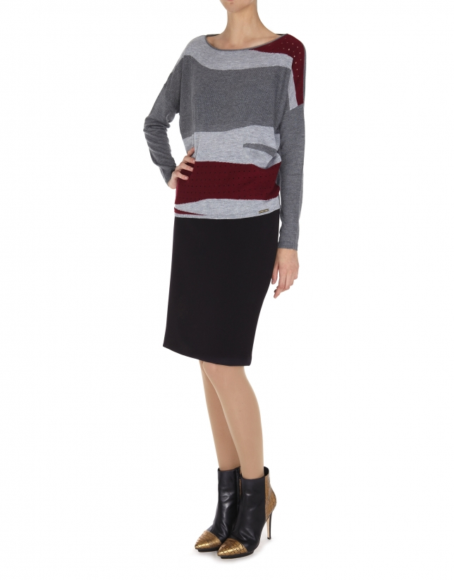 Gray and red dolman sleeve sweater.