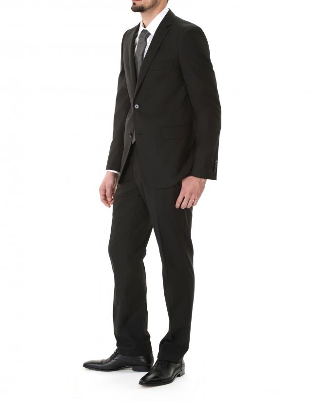 Veste costume unie noire.