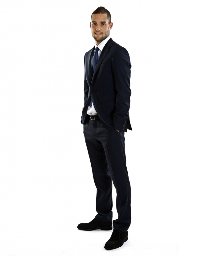 Navy blue Atlético de Madrid soccer club suit.