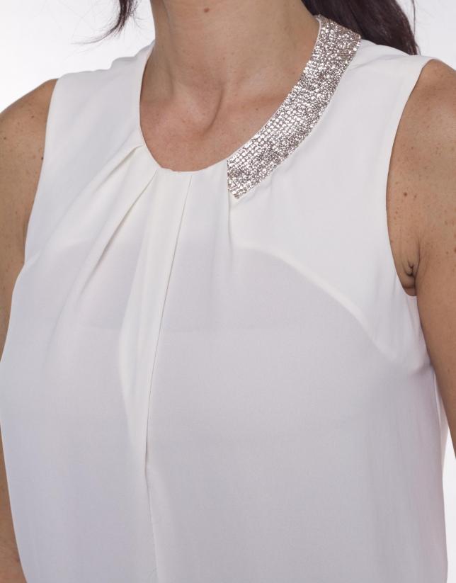Round neck top with asymmetric beading