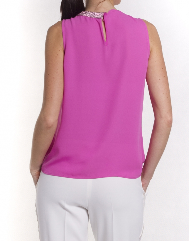 Round neck top with asymmetric beading