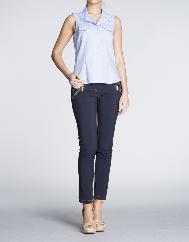 Sleeveless blue and white Vichy shirt