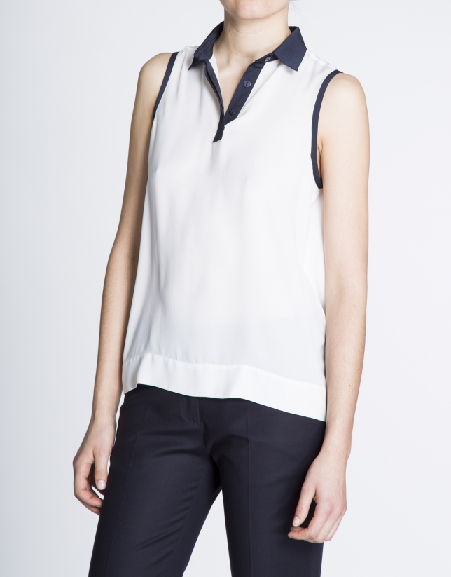 Off white sleeveless blouse