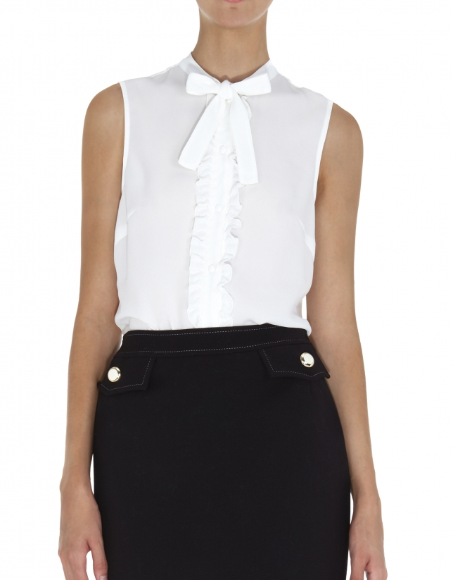 White top with bow at neck