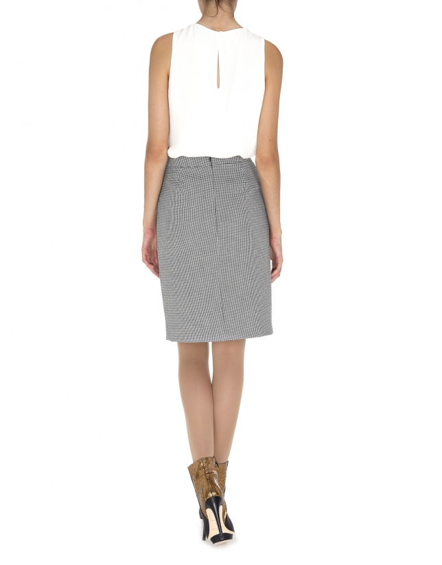Ivory sleeveless top with tie at neck