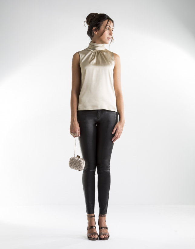 Sandy-colored top with high collar