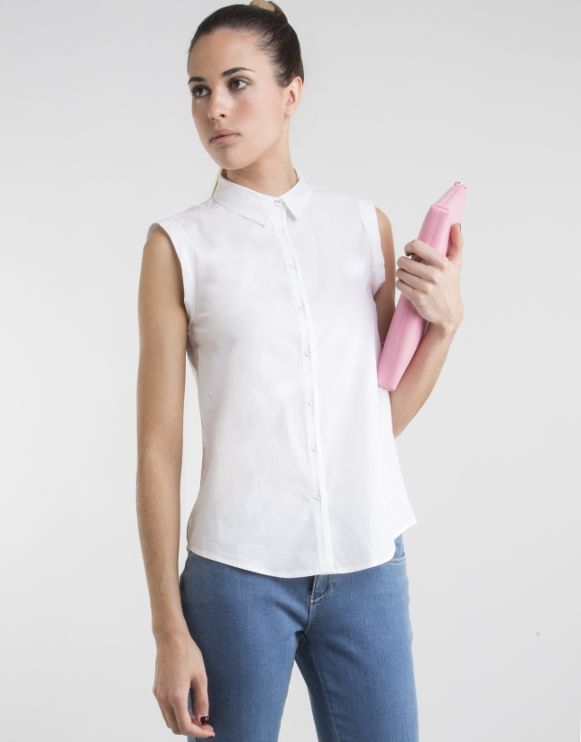 Sleeveless white shirt