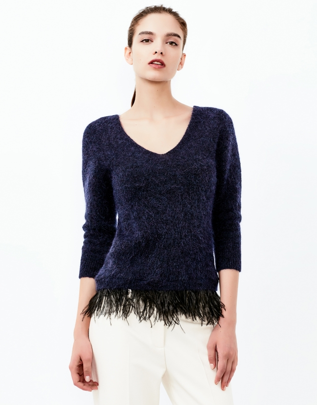 Blue sweater with feathers