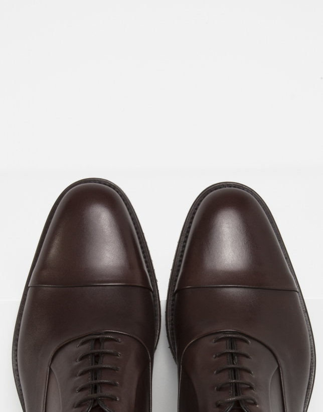 Brown shoes with slits