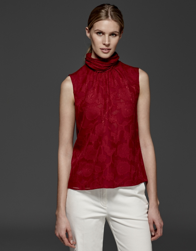 Maroon top with high draped collar