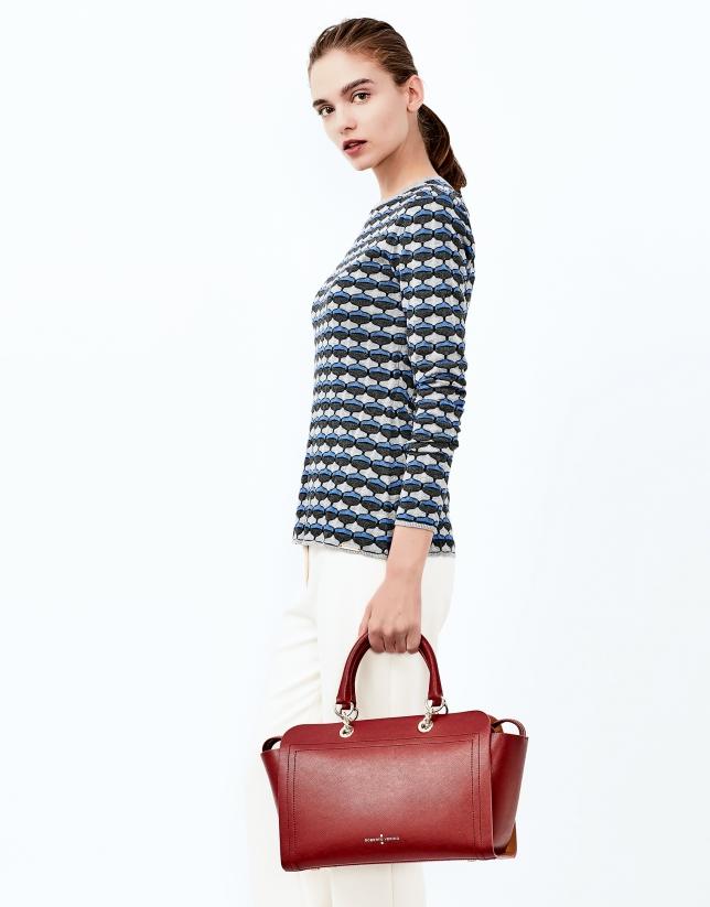Blue geometric print knit top